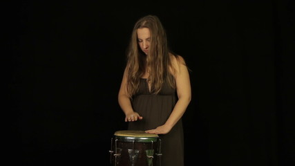 Woman playing on the drum