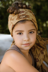 Portrait of a beautiful young girl with head scarf