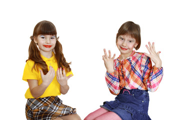 Two cute girls demonstrate painted nails