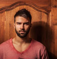 Attractive men indoor. Close-up photo.