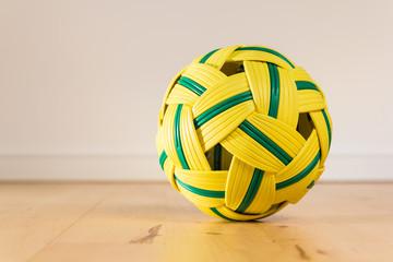 Takraw ball on wood floor