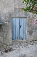 old blue door on old facade