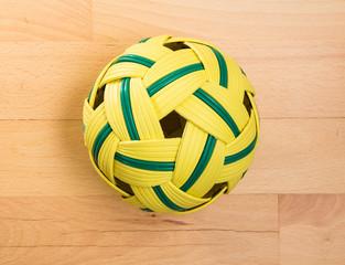 Rattan ball lying on beech floor