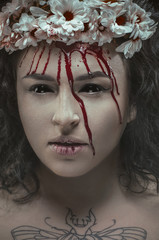 Woman with bloody wreath