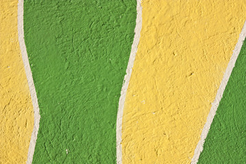 yellow and green textured stucco background