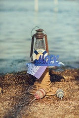 on sea background scenery of a rope with buoys, lantern and life