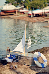 on the bank of a miracle boat with sails trough