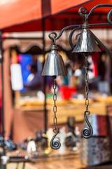 Metal bels over blurred background.