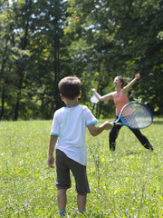 Mother and son playing tennis