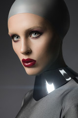 Fashion shot of a woman in a silver suit
