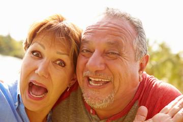 Head and Shoulders Portrait Of Senior Couple In Garden