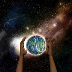 Female hands protecting the Earth
