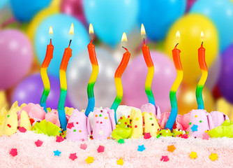 Birthday cake with candles on bright background