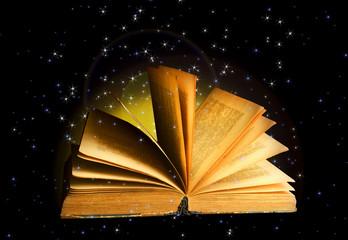 Magical book on dark background