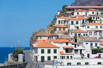 Houses Camara de Lobos against a cliff at Madeira Island