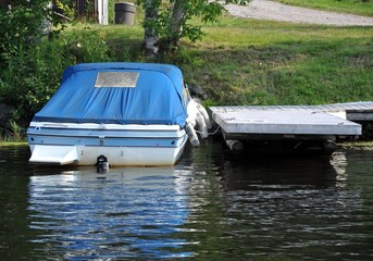 Motor boat parked in a wooden dock