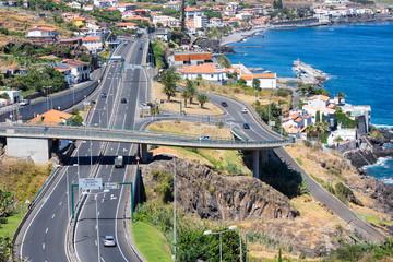 Aerial view at coast Madeira with Highway along Santa Cruz