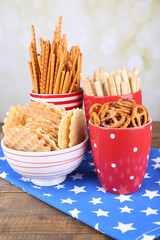 Dry breakfast, sticks and biscuits in red polka dot cup and