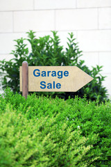 Garage sale sign at park