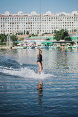 Young woman wakeboarding on the sea