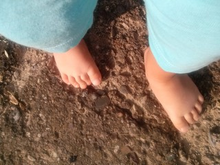 Barefoot baby outside