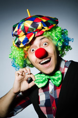 Funny clown against the dark background