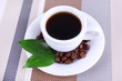 Cup of fresh hot coffee on table cloth
