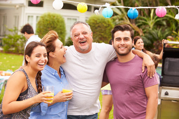 Parent With Adult Children Enjoying Party In Garden
