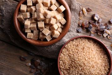 Brown sugar cubes, reed and crystal sugar in bowl