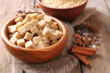 Brown sugar cubes, reed and crystal sugar in bowl with spices