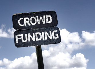 Crowd Funding sign with clouds and sky background