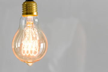 Close up of vintage glowing light bulb
