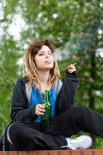 canvas print picture Teenage girl drinking beer and smoking cigarette