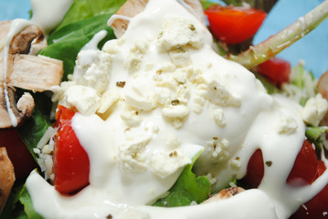 Close-Up of Creamy Dressing with Feta on Fresh Salad
