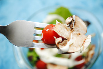 Eating a Sliced Mushroom and Cherry Tomato on a Fork