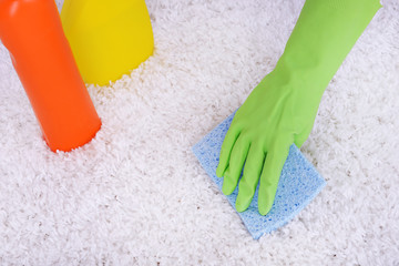 Cleaning carpet with cloth close up