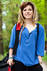 Smiling teenage girl with travel bag