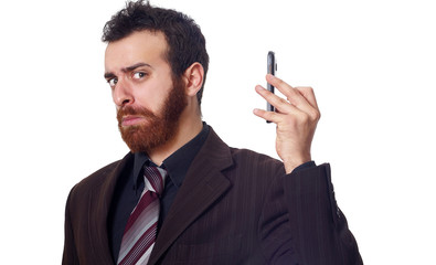 businessman puts his phone away from his ear