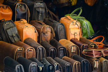 Group of leather bags in shop
