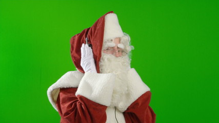 Santa Claus with Headphones - Listening to Music