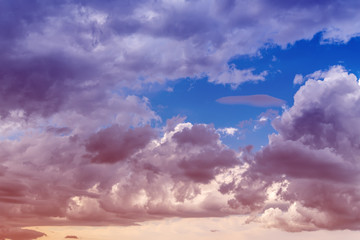 Clouds with blue sky background. Color toned image.