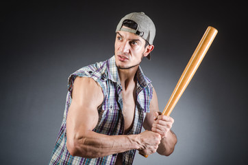 Violent man with baseball bat and hat