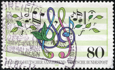 stamp shows musical notes, treble clef, leaves