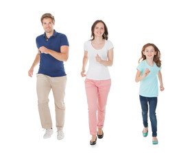 Family Walking In A Row Over White Background
