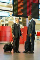 businessmen travelling together
