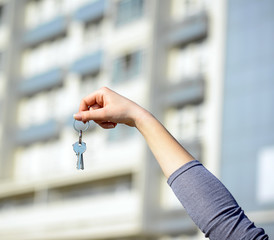 Woman's hand holding keys to new home