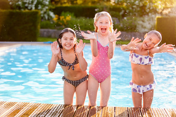 Group Of Girls Playing In Outdoor Swimming Pool