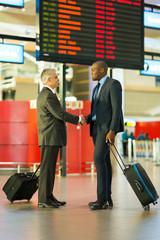 businessmen meeting at airport