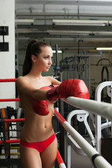 Sexy female boxer waiting for her opponent in ring