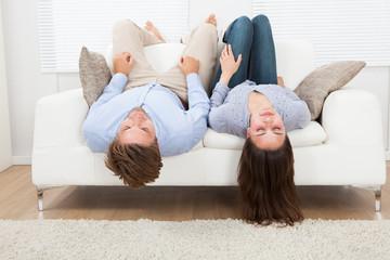 Couple Sleeping On Sofa At Home